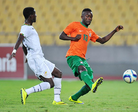 Daniel Darkwah of Ghana challenged by Aaron Katebe of Zambia during the 2015 Cosafa Cup Plate Semi Finals match between Zambia and Ghana at Royal Bafokeng Stadium, Rustenburg on the 27 May 2015  ©Muzi Ntombela/BackpagePix