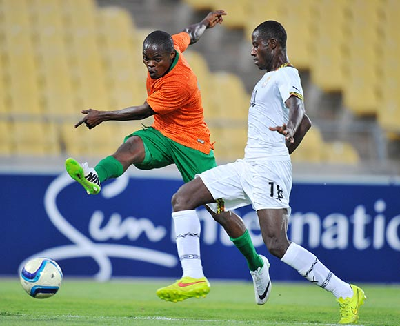 Allan Mukuka of Zambia challenged by Adams Ahmed of Ghana during the 2015 Cosafa Cup Plate Semi Finals match between Zambia and Ghana at Royal Bafokeng Stadium, Rustenburg on the 27 May 2015  ©Muzi Ntombela/BackpagePix