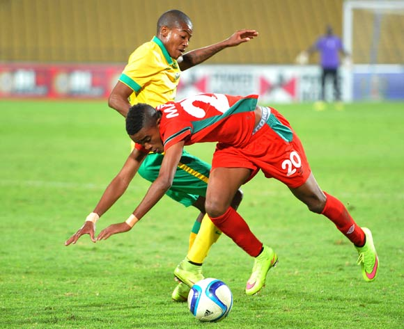 Gerald Phiri of Malawi battles with Thapelo Morena of South Africa during the 2015 Cosafa Cup Plate Semi Finals match between South Africa and Malawi at Royal Bafokeng Stadium, Rustenburg on the 27 May 2015