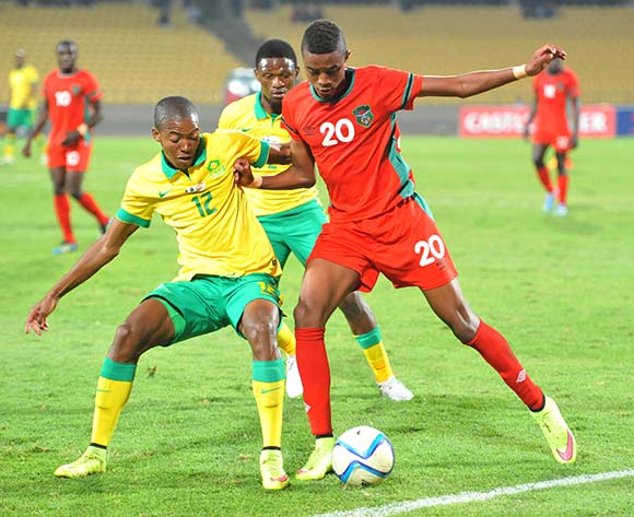 Gerald Phiri of Malawi battles with Thapelo Morena of South Africa during the 2015 Cosafa Cup Plate Semi Finals match between South Africa and Malawi at Royal Bafokeng Stadium, Rustenburg on the 27 May 2015  ©Muzi Ntombela/BackpagePix