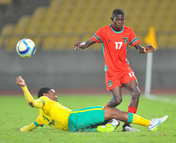 Micium Mhone of Malawi tackled by Motjeka Madisha of South Africa during the 2015 Cosafa Cup Plate Semi Finals match between South Africa and Malawi at Royal Bafokeng Stadium, Rustenburg on the 27 May 2015