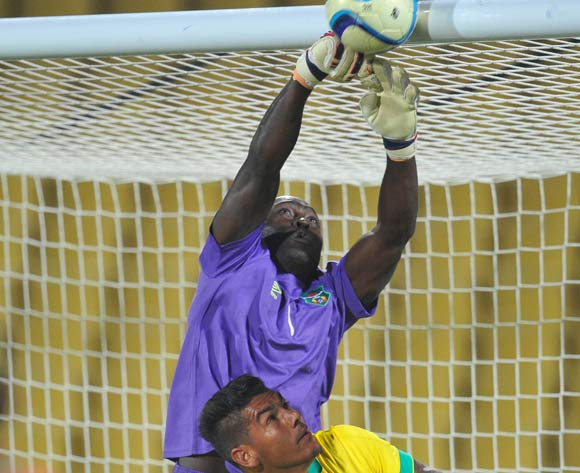 McDanard Harawa of Malawi battles with Clayton Daniels of South Africa during the 2015 Cosafa Cup Plate Semi Finals match between South Africa and Malawi at Royal Bafokeng Stadium, Rustenburg on the 27 May 2015