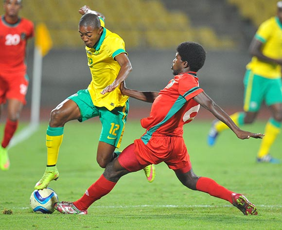 Thapelo Morena of South Africa tackled by Livison Fodya of Malawi during the 2015 Cosafa Cup Plate Semi Finals match between South Africa and Malawi at Royal Bafokeng Stadium, Rustenburg on the 27 May 2015  ©Muzi Ntombela/BackpagePix