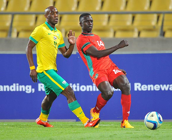 Limbikani Mzava of Malawi challenged by Carl Lark of South Africa during the 2015 Cosafa Cup Plate Semi Finals match between South Africa and Malawi at Royal Bafokeng Stadium, Rustenburg on the 27 May 2015  ©Muzi Ntombela/BackpagePix