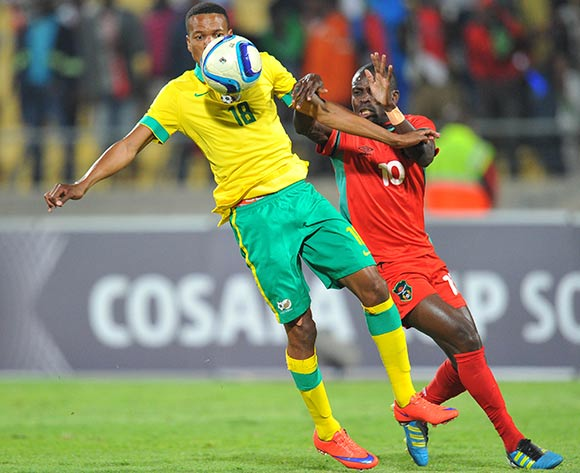 Tlou Segolela of South Africa challenged by John Banda of Malawi during the 2015 Cosafa Cup Plate Semi Finals match between South Africa and Malawi at Royal Bafokeng Stadium, Rustenburg on the 27 May 2015  ©Muzi Ntombela/BackpagePix