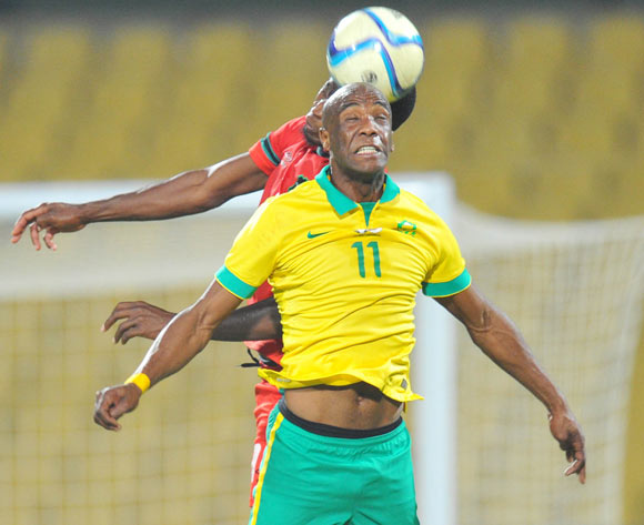 Carl Lark of South Africa battles with Lucky Malata of Malawi during the 2015 Cosafa Cup Plate Semi Finals match between South Africa and Malawi at Royal Bafokeng Stadium, Rustenburg on the 27 May 2015