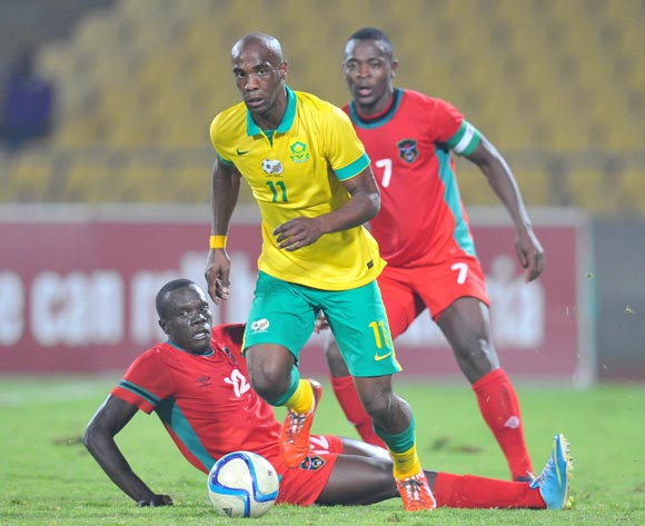 Carl Lark of South Africa tackled by Chimango Kayira of Malawi during the 2015 Cosafa Cup Plate Semi Finals match between South Africa and Malawi at Royal Bafokeng Stadium, Rustenburg on the 27 May 2015
