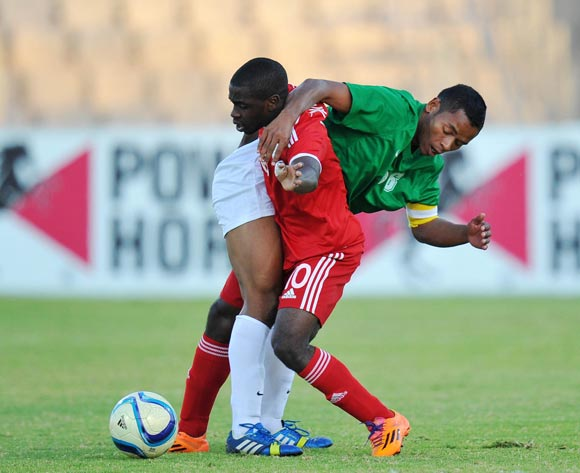 Wangu Gome of Namibia battles with Rabeson Michael of Madagascar during the 2015 Cosafa Cup Plate Semi Finals match between Zambia and Ghana at Moruleng Stadium, Rustenburg on the 28 May 2015