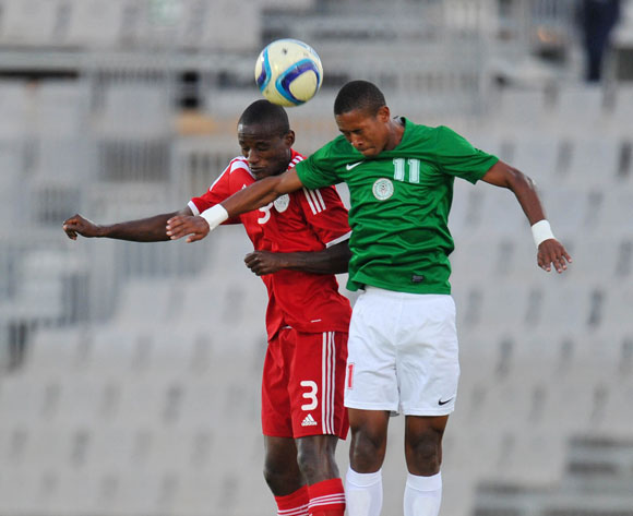 Ananias Gebhardt of Namibia battles with Rakotoharimalala Martin of Madagascar during the 2015 Cosafa Cup Plate Semi Finals match between Zambia and Ghana at Moruleng Stadium, Rustenburg on the 28 May 2015