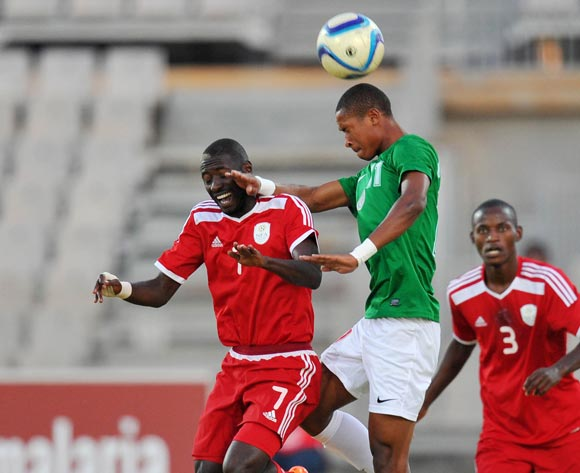 Deon Hotto of Namibia battles with Rakotoharimalala Martin of Madagascar during the 2015 Cosafa Cup Plate Semi Finals match between Zambia and Ghana at Moruleng Stadium, Rustenburg on the 28 May 2015