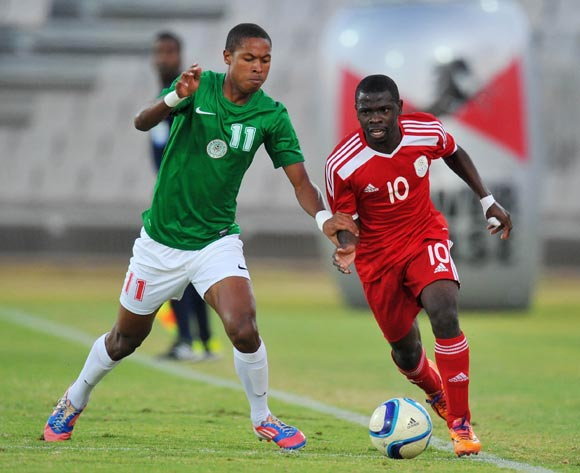 Wangu Gome of Namibia challenged by Rakotoharimalala Martin of Madagascar during the 2015 Cosafa Cup Plate Semi Finals match between Zambia and Ghana at Moruleng Stadium, Rustenburg on the 28 May 2015