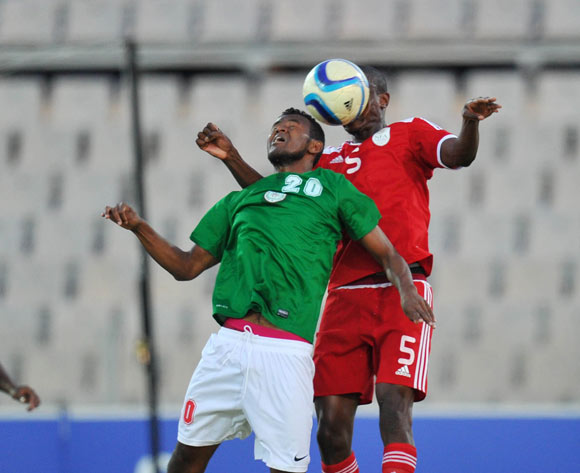 Rihno Michel of Madagascar battles with Chris Katjiukua of Namibia during the 2015 Cosafa Cup Plate Semi Finals match between Zambia and Ghana at Moruleng Stadium, Rustenburg on the 28 May 2015