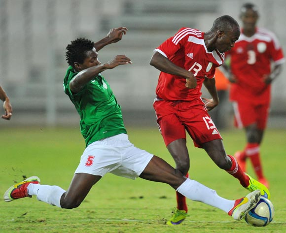 Peter Shalulile of Namibia tackled by Rabeson Michael of Madagascar during the 2015 Cosafa Cup Plate Semi Finals match between Zambia and Ghana at Moruleng Stadium, Rustenburg on the 28 May 2015