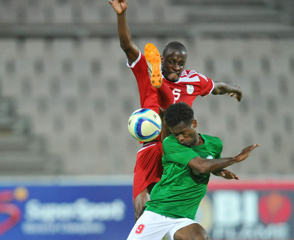 Sarivahy Vombola of Madagascar battles with Chris Katjiukua of Namibia during the 2015 Cosafa Cup Plate Semi Finals match between Zambia and Ghana at Moruleng Stadium, Rustenburg on the 28 May 2015