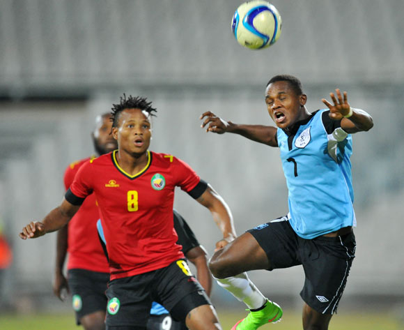 Kabelo Seakanyeng of Botswana challenged by Edmilson Dove of Mozambique during the 2015 Cosafa Cup Semi Finals match between Botswana and Mozambique at Moruleng Stadium, Rustenburg on the 28 May 2015