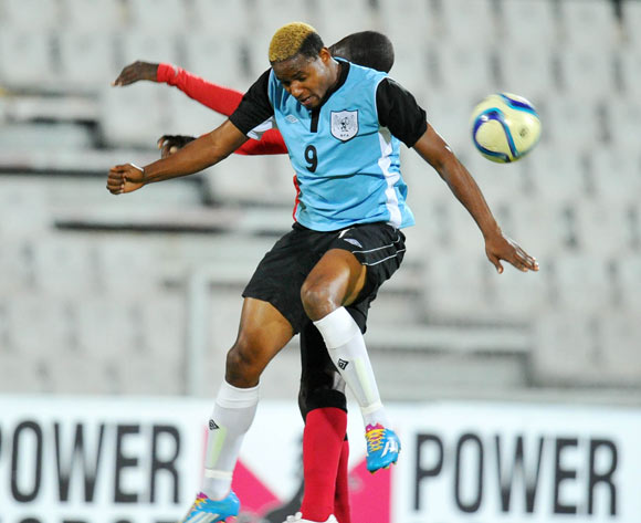 Omaatla Kebatho of Botswana battles with Momed Hagi of Mozambique during the 2015 Cosafa Cup Semi Finals match between Botswana and Mozambique at Moruleng Stadium, Rustenburg on the 28 May 2015