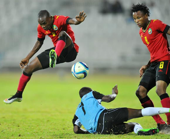 Saddan Guambe of Mozambique battles with Kabelo Seakanyeng of Botswana during the 2015 Cosafa Cup Semi Finals match between Botswana and Mozambique at Moruleng Stadium, Rustenburg on the 28 May 2015