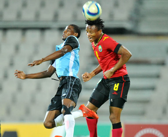 Segolame Boy of Botswana battles with Edmilson Dove of Mozambique during the 2015 Cosafa Cup Semi Finals match between Botswana and Mozambique at Moruleng Stadium, Rustenburg on the 28 May 2015