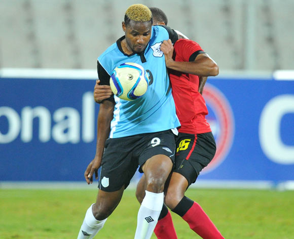 Omaatla Kebatho of Botswana challenged by Francisco Muchanga of Mozambique during the 2015 Cosafa Cup Semi Finals match between Botswana and Mozambique at Moruleng Stadium, Rustenburg on the 28 May 2015