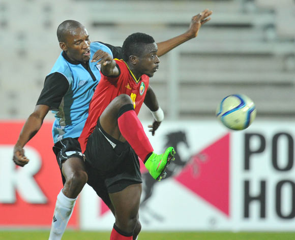 Isac Decarvalho of Mozambique challenged by Obuile Ncenga of Botswana during the 2015 Cosafa Cup Semi Finals match between Botswana and Mozambique at Moruleng Stadium, Rustenburg on the 28 May 2015