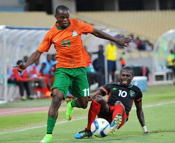 Allan Mukuka of Zambia tackled by John Banda of Malawi during the 2015 Cosafa Cup Plate Finals match between Zambia and Malawi at Royal Bafokeng Stadium, Rustenburg on the 29 May 2015
