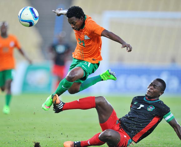 Lucky Malata of Malawi battles with Jackson Mwanza of Zambia during the 2015 Cosafa Cup Plate Finals match between Zambia and Malawi at Royal Bafokeng Stadium, Rustenburg on the 29 May 2015