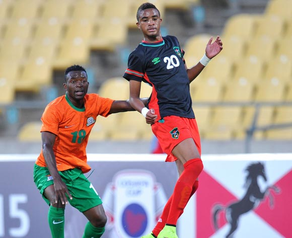 Gerald Phiri of Malawi challenged by Emmanuel Mbola of Zambia during the 2015 Cosafa Cup Plate Finals match between Zambia and Malawi at Royal Bafokeng Stadium, Rustenburg on the 29 May 2015