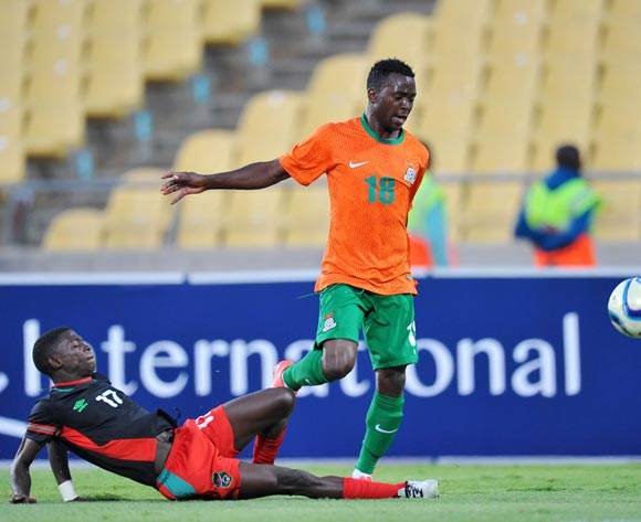 Emmanuel Mbola of Zambia tackled by Miciam Mhome of Malawi during the 2015 Cosafa Cup Plate Finals match between Zambia and Malawi at Royal Bafokeng Stadium, Rustenburg on the 29 May 2015