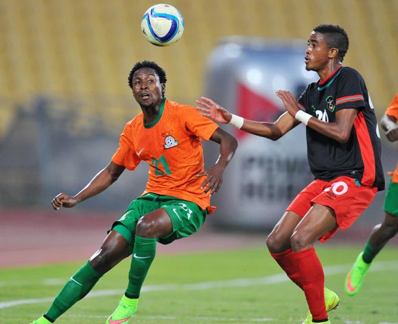 Jackson Mwanza of Zambia battles with Gerald Phiri of Malawi during the 2015 Cosafa Cup Plate Finals match between Zambia and Malawi at Royal Bafokeng Stadium, Rustenburg on the 29 May 2015