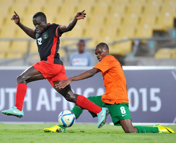 Chimango Kayira of Malawi tackled by Paul Katema of Zambia during the 2015 Cosafa Cup Plate Finals match between Zambia and Malawi at Royal Bafokeng Stadium, Rustenburg on the 29 May 2015