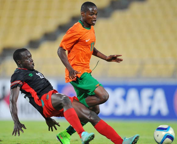 Allan Mukuka of Zambia tackled by Chimango Kayira of Malawi during the 2015 Cosafa Cup Plate Finals match between Zambia and Malawi at Royal Bafokeng Stadium, Rustenburg on the 29 May 2015