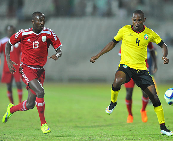 Saddan Guambe of Mozambique challenged by Peter Shalulile of Namibia during the 2015 Cosafa Cup final match between Namibia and Mozambique at the Moruleng Stadium in Rustenburg, South Africa on May 30, 2015 ©Samuel Shivambu/BackpagePix