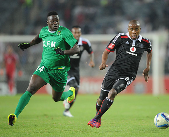 Thabo Matlaba of Orlando Pirates is challenged by Ovedrago Ovedrago of CF Mounana during the CAF Confederation Cup match between Orlando Pirates and FC Mounana  on 02 May 2015 at Orlando Stadium Pic Sydney Mahlangu/BackpagePix