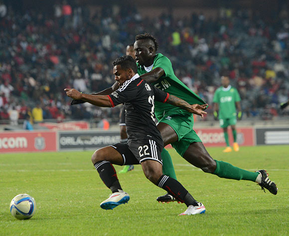 Kermit Erasmus of Orlando Pirates is challenged by Badara Diouf of CF Mounana during the CAF Confederation Cup match between Orlando Pirates and FC Mounana  on 02 May 2015 at Orlando Stadium Pic Sydney Mahlangu/BackpagePix