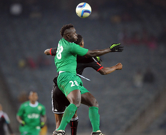 Thamsanqa Gabuza of Orlando Pirates is challenged by Badara Diouf of CF Mounana during the CAF Confederation Cup match between Orlando Pirates and FC Mounana  on 02 May 2015 at Orlando Stadium Pic Sydney Mahlangu/BackpagePix
