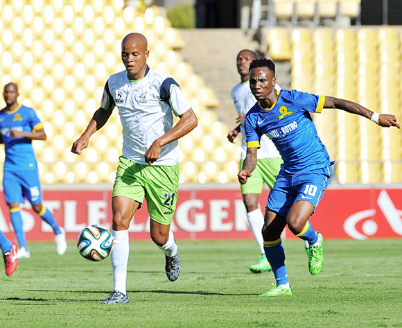 Solomon Mathe of Platinum Stars challenged by Teko Modise of Mamelodi Sundowns during the Absa Premiership 2014/15 match between Platinum Stars and Mamelodi Sundownsd at the Royal Bafokeng Stadium in Rustenburg, South Africa on May 03, 2015 ©Samuel Shivambu/BackpagePix