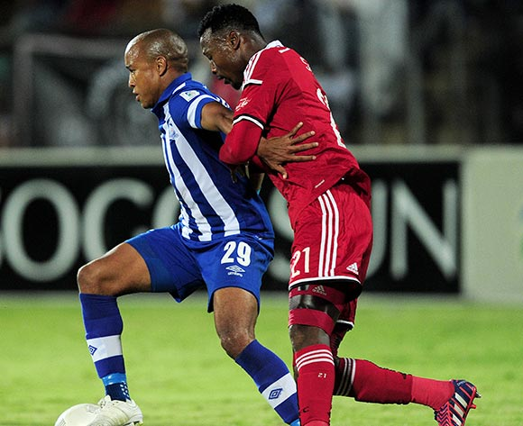 Tussle between Kurt Lentjies of Maritzburg United FC and Siyabonga Sangweni of Orlando Pirates during the Absa Premiership match between Maritzburg United and Orlando Pirates at the Harry Gwala Stadium in Pietermaritzburg South Africa on May 06, 2015 ©Gerhard Duraan/BackpagePix