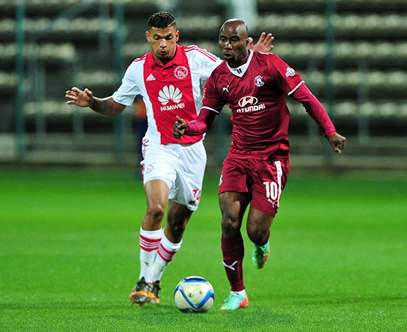 Siyabonga Nomvethe of Moroka Swallows pulls away from Toriq Losper of Ajax Cape Town during the Absa Premiership 2014/15 game between Ajax Cape Town and Moroka Swallows at Athlone Stadium, Cape Town on 6 May 2015 ©Ryan Wilkisky/BackpagePix