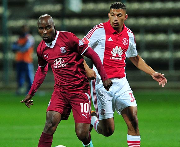 Siyabonga Nomvethe of Moroka Swallows takes on Toriq Losper of Ajax Cape Town during the Absa Premiership 2014/15 game between Ajax Cape Town and Moroka Swallows at Athlone Stadium, Cape Town on 6 May 2015 ©Ryan Wilkisky/BackpagePix