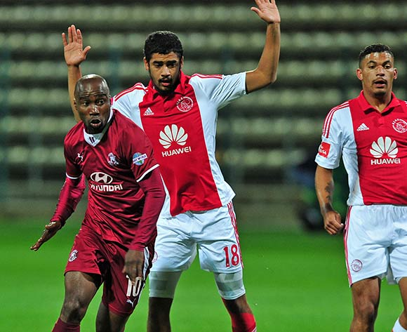 Siyabonga Nomvethe of Moroka Swallows takes on Abbubaker Mobara of Ajax Cape Town during the Absa Premiership 2014/15 game between Ajax Cape Town and Moroka Swallows at Athlone Stadium, Cape Town on 6 May 2015 ©Ryan Wilkisky/BackpagePix