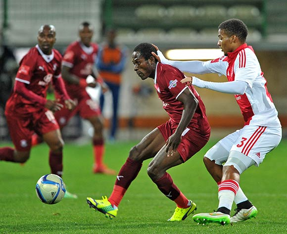 Felix Obada of Moroka Swallows holds the ball up ahead of Rivaldo Coetzee of Ajax Cape Town during the Absa Premiership 2014/15 game between Ajax Cape Town and Moroka Swallows at Athlone Stadium, Cape Town on 6 May 2015 ©Ryan Wilkisky/BackpagePix