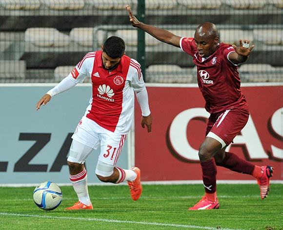 Riyaad Norodien of Ajax Cape Town holds the ball up ahead of Sipho Mngomezulu of Moroka Swallows during the Absa Premiership 2014/15 game between Ajax Cape Town and Moroka Swallows at Athlone Stadium, Cape Town on 6 May 2015 ©Ryan Wilkisky/BackpagePix