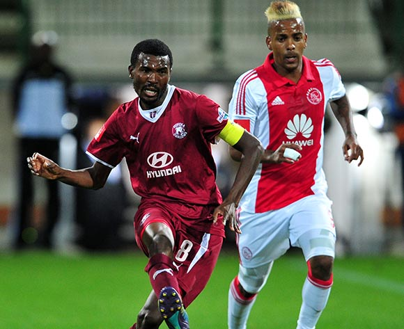 Lucky Baloyi of Moroka Swallows gets his pass away ahead of Erwin Isaacs of Ajax Cape Town during the Absa Premiership 2014/15 game between Ajax Cape Town and Moroka Swallows at Athlone Stadium, Cape Town on 6 May 2015 ©Ryan Wilkisky/BackpagePix