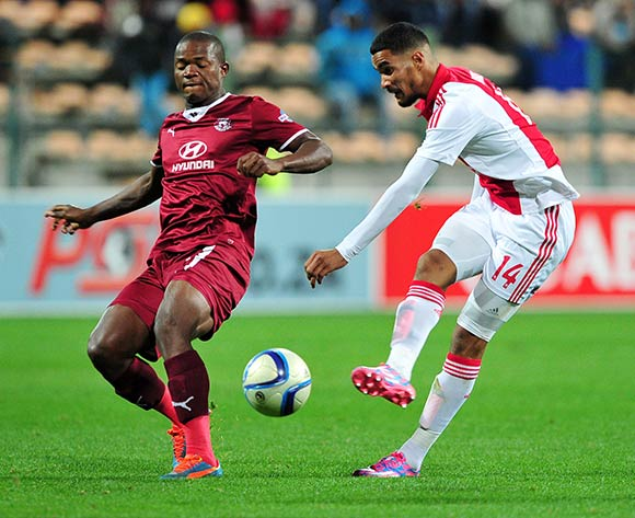 Tashreeq Morris of Ajax Cape Town shoots at goal as Lantshene Phalane of Moroka Swallows makes the block tackle during the Absa Premiership 2014/15 game between Ajax Cape Town and Moroka Swallows at Athlone Stadium, Cape Town on 6 May 2015 ©Ryan Wilkisky/BackpagePix