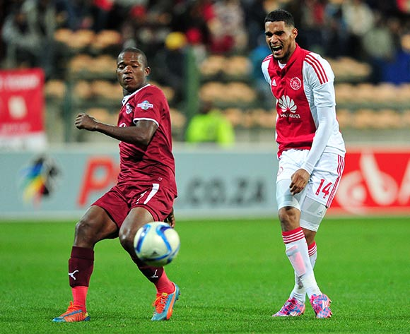 Tashreeq Morris of Ajax Cape Town grimaces after Lantshene Phalane of Moroka Swallows makes the tackle during the Absa Premiership 2014/15 game between Ajax Cape Town and Moroka Swallows at Athlone Stadium, Cape Town on 6 May 2015 ©Ryan Wilkisky/BackpagePix