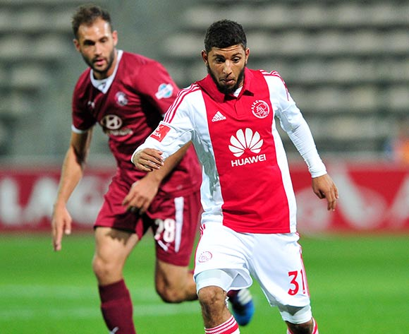 Riyaad Norodien of Ajax Cape Town on the ball ahead of Larry Cohen of Moroka Swallows during the Absa Premiership 2014/15 game between Ajax Cape Town and Moroka Swallows at Athlone Stadium, Cape Town on 6 May 2015 ©Ryan Wilkisky/BackpagePix