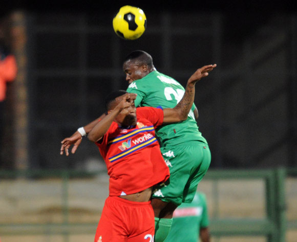 Grant Kekana of University of Pretoria challenges for the ball with Bornwell Mwape of AmaZulu during the Absa Premiership match between Tuks and AmaZulu  on 06 May 2015 at Tuks Stadium