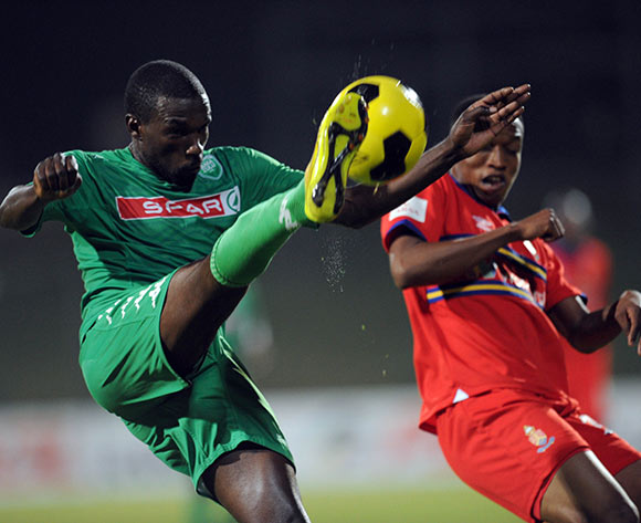 Willem Mwedihanga of AmaZulu clears the ball ahead of Grant Kekana of University of Pretoria   during the Absa Premiership match between Tuks and AmaZulu  on 06 May 2015 at Tuks Stadium Pic Sydney Mahlangu/BackpagePix