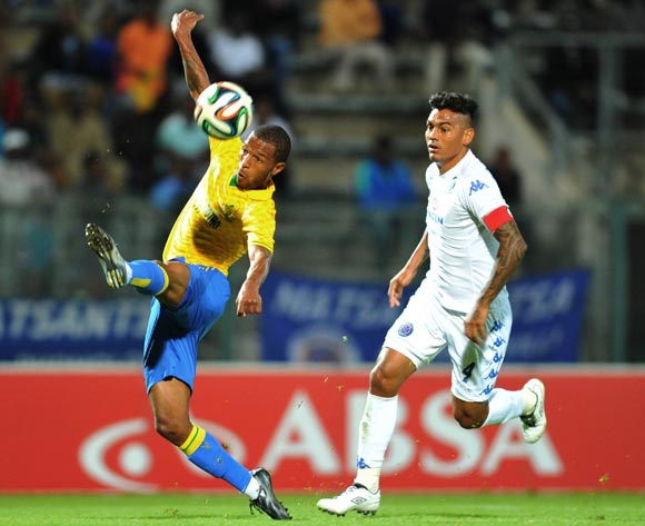 Mzikayise Mashaba of Mamelodi Sundowns challenged by Clayton Daniels of Supersport United during the Absa Premiership 2014/15 match between Supersport United and Mamelodi Sundownsd at the Lucas Moripe Stadium in Pretoria, South Africa on May 06, 2015