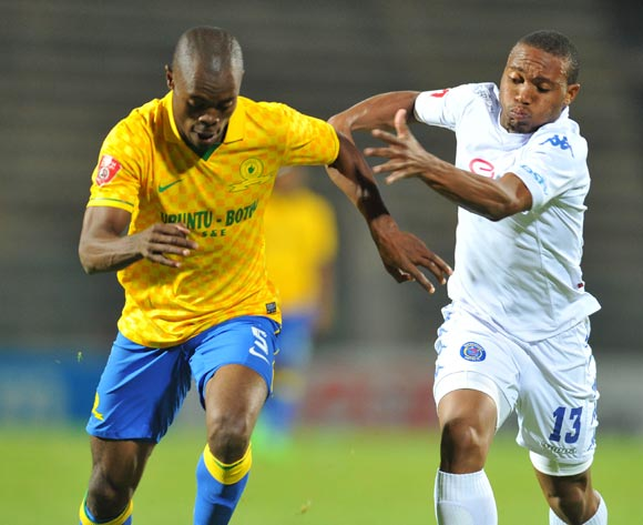 Asavela Mbekile of Mamelodi Sundowns challenged by Thuso Phala of Supersport United during the Absa Premiership 2014/15 match between Supersport United and Mamelodi Sundownsd at the Lucas Moripe Stadium in Pretoria, South Africa on May 06, 2015